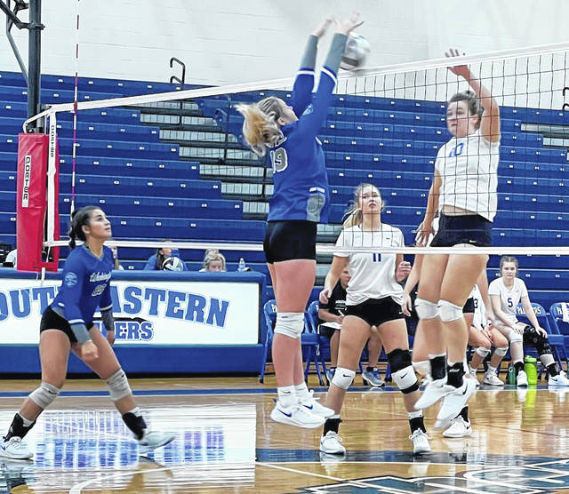 Washington's Calleigh Wead-Salmi gets a solo block during a tri-match at Southeastern High School Saturday, Aug. 28, 2021. Also pictured for Washington is Aaralyne Estep.