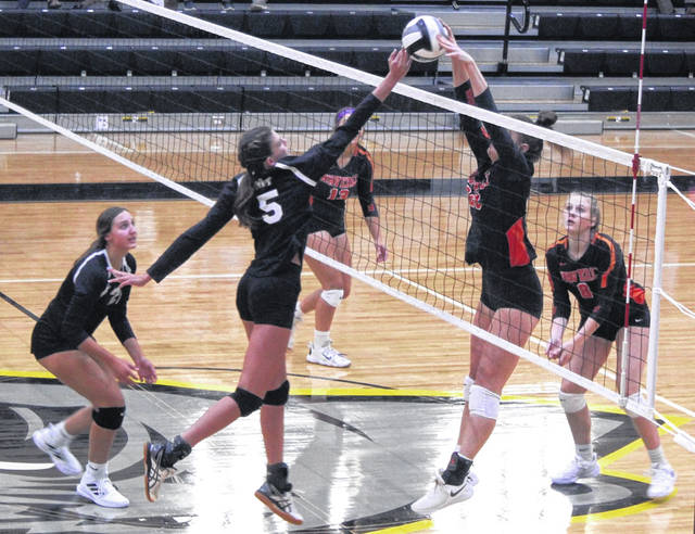 Addy Butts (5) makes a play at the net for Miami Trace during the Lady Panthers' season-opening match against Waverly Monday, Aug. 23, 2021 at Miami Trace High School. Also pictured for Miami Trace is Gracey Ferguson.