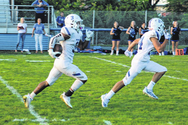 Washington junior Trevaughn Jackson, left, returns a punt 56-yards for a touchdown against the Bexley Lions Friday, Aug. 20, 2021 at Gardner Park. Leading the way is sophomore Brayeson Self.