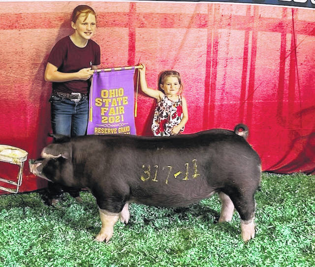 Hallie and Hayden Penwell had a very successful week at the state fair as they won the 2021 Ohio State Fair Reserve Grand Champion Poland Breeding Gilt prize in the open show.