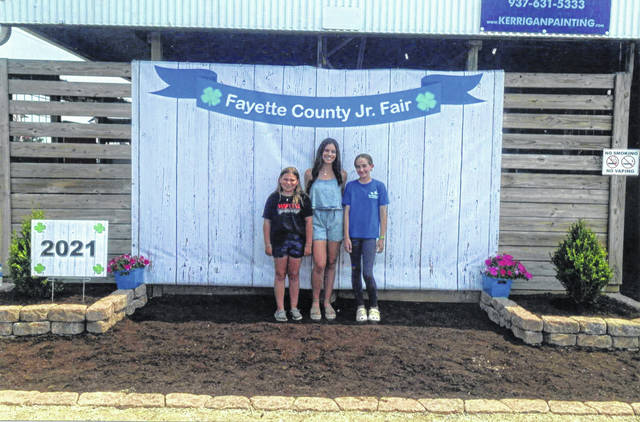 Pictured left to right: State Fair Representatives Frankie Helsel and Madison Johnson with Taylor Payton, who competed at the National Cutting Horse Association Finals.