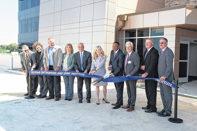 On Friday, Adena Health System's leadership was joined by several officials to celebrate the pending Sept. 1 opening of the Chillicothe-based Adena Orthopedic and Spine Institute (AOSI) with an official ribbon cutting.