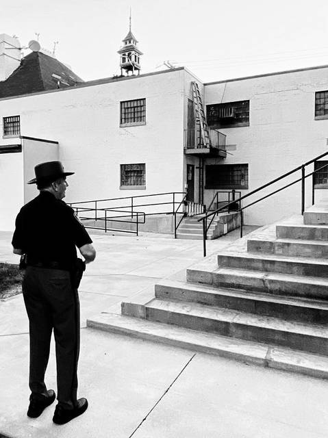 Charlie Wise looked on at the old jail one last time before it was torn down. He is the only one remaining active who has 50 years of service in the former jail building.