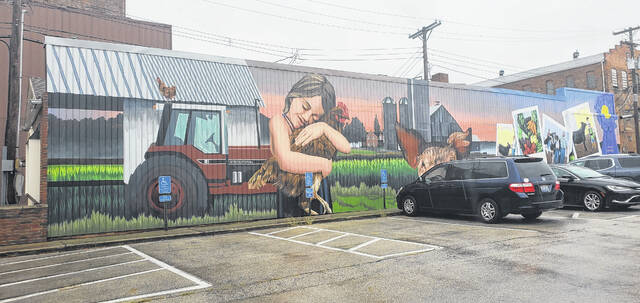 The Fayette County Farmers Market mural, located on the side of the Kiger and Kiger building that faces the parking lot where the Farmers Market is held, has been completed.