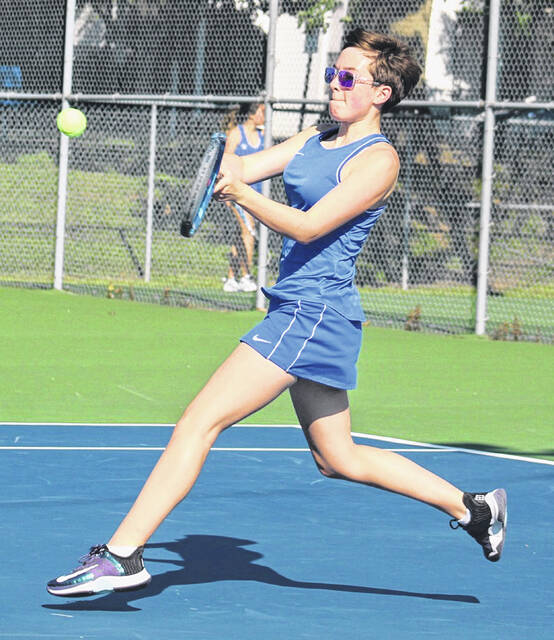 Washington's Abby Rose hits the return during a third singles match against Chillicothe at Gardner Park Tuesday, Sept. 7, 2021.
