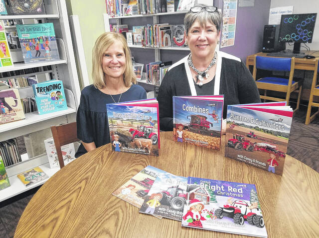 Carnegie Public Library was recently the recipient of a series of agriculture books thanks to Fayette County Farm Bureau. Pictured are Lisa Peterson (left), Farm Bureau trustee, and Anne Quinn, head of children's services at Carnegie Public Library.