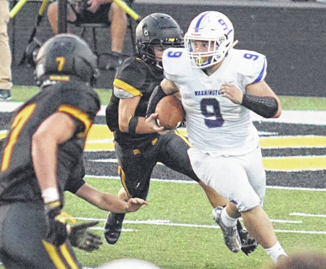 Washington senior Drew Hardy (9) carries during the game at Paint Valley High School Friday, Sept. 3, 2021.