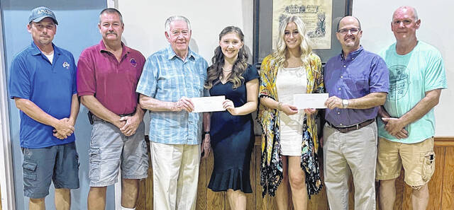 Elks Lodge #129 recently announced the 2021 scholarship winners: Analese Mitson and Olivia Fliehman. From left to right are Tyler Osborne-PER Elks 129, Dennis Noble-exalted ruler Elks 129, Edward Helt Jr.-PER Elks 129, Analese Mitson, Olivia Fliehman, Matt Barga-scholarship committee, and Tom Shields-Elks 129 trustee.