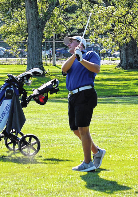 Washington's Garrett Wahl watches the flight of his approach shot during a non-conference match at The Greens Tuesday, Sept. 7, 2021.
