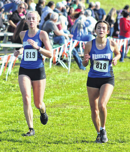 Washington's Isabella Racine (left) and Mia Moats compete in the cross country meet at Rio Grande Saturday, Sept. 25, 2021.
