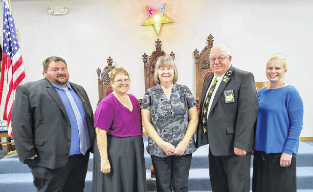 From left to right, Associate Patron Dale Mayer, Worthy Matron Betty Hoppes, 50-year member Deborah Carr, Worthy Patron Mark Hoppes and Associate Matron Nicole Cook.