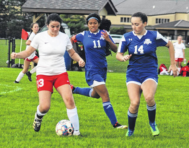 The Washington Lady Lion soccer team hosted Jackson for a Frontier Athletic Conference match Thursday, Sept. 23, 2021. Jackson won the match, 5-0. The score was 0-0 at the half. Above, Kaithlyn Maquiling (11) and Jordan McCane (14) defend. Washington is scheduled to play at McClain Tuesday at 5 p.m.