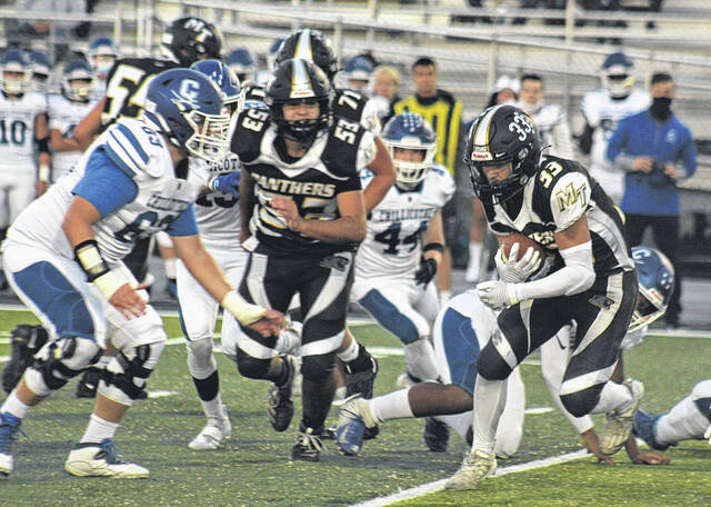 Landen Cope (33) carries for Miami Trace during the first half of the Frontier Athletic Conference opener against Chillicothe Friday, Sept. 24, 2021. Also pictured for Miami Trace is Bryson Sheets (53).