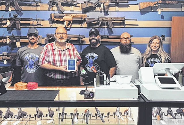 The City of Washington Court House recently recognized Xiphos Armory at its grand opening with a new business plaque. From left to right are: Jay Southworth, Joe Denen, Alex Rosado, Brian Blade and Miranda Hanna. Located at 110 E. Market St., store hours are 9 a.m. to 5 p.m. Monday-Friday and 9 a.m. to 8 p.m. on Saturdays.