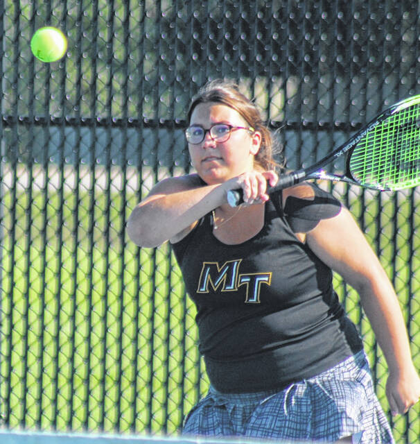 Miami Trace's Deanna Page returns a shot during a first doubles match against Chillicothe played at Miami Trace High School Thursday, Sept. 2, 2021.