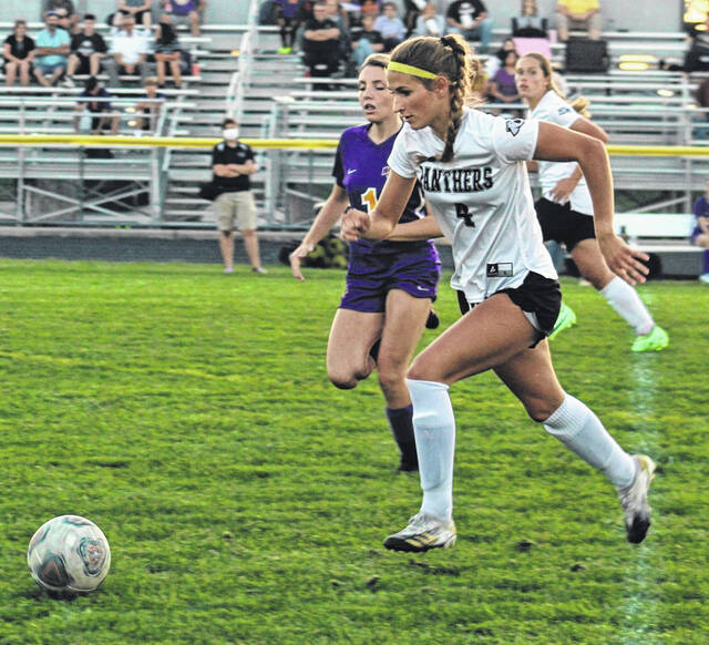 Miami Trace's Jana Griffith advances the ball up the field, guarded by McClain's Ryan Butterbaugh, during a Frontier Athletic Conference game at McClain High School Thursday, Sept. 16, 2021. McClain won the match, 4-0. Miami Trace is scheduled to host the Washington Lady Lions Tuesday at 5 p.m.