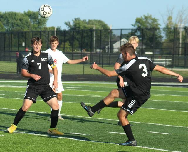Miami Trace senior Hayden Hunter (3) clears the ball during a Frontier Athletic Conference match against Jackson Thursday, Sept. 2, 2021. Also pictured for Miami Trace are seniors Connor Bucher (7) and Anthony Langley.