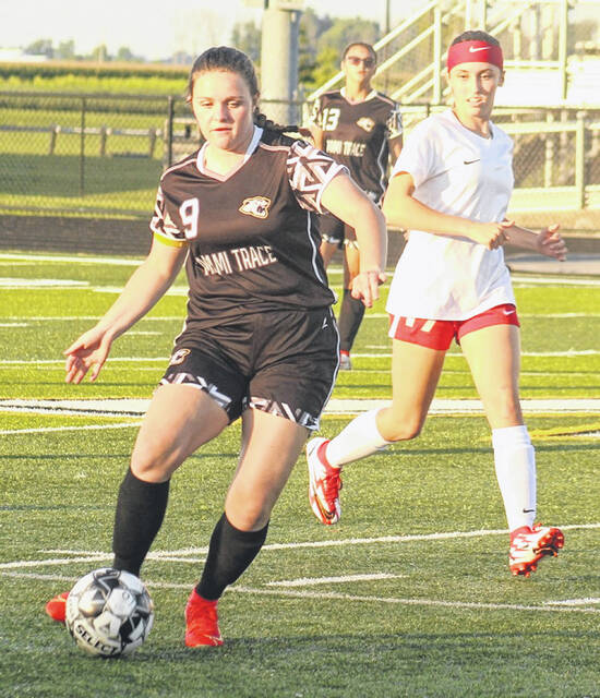 Miami Trace senior Kandice Mathews (9) advances the ball up the field during a Frontier Athletic Conference home match against Jackson Thursday, Sept. 2, 2021. Jackson won, 4-0 with two goals in the first half and two in the second. Miami Trace is at Circleville Saturday at 3 p.m. Also pictured for Miami Trace is junior Emma See.