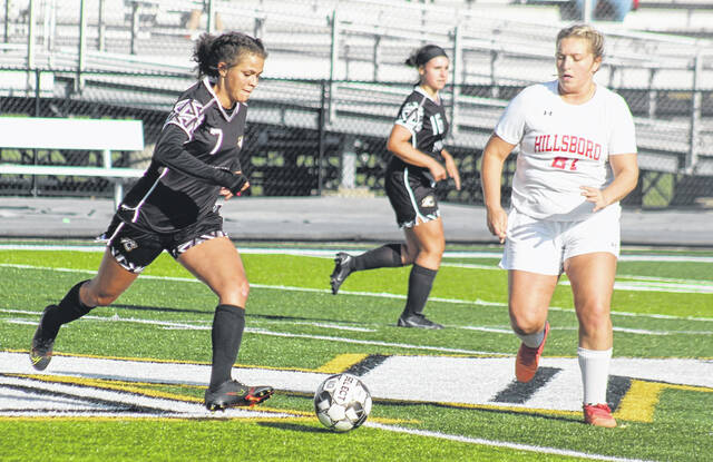 """Miami Trace's Keeley Ramirez (7) advances the ball up-field during a Frontier Athletic Conference match at home against Hillsboro Thursday, Sept. 23, 2021. Also pictured for Miami Trace is Katie Hynes (16). Hillsboro won the match, 7-1. The score was 6-0 at the half. """"We were pleased as a coaching staff with our play in the second half,"""" Miami Trace head coach Chad Tolbert said. Jana Griffith scored for Miami Trace. The Lady Panthers are scheduled to play at Jackson Tuesday and at Chillicothe Thursday."""