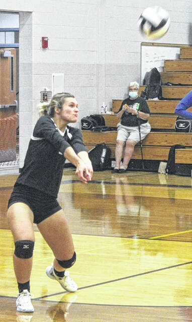 Miami Trace's Kennedy Kelley makes the play from the back row during a Frontier Athletic Conference match at McClain High School Thursday, Sept. 16, 2021.