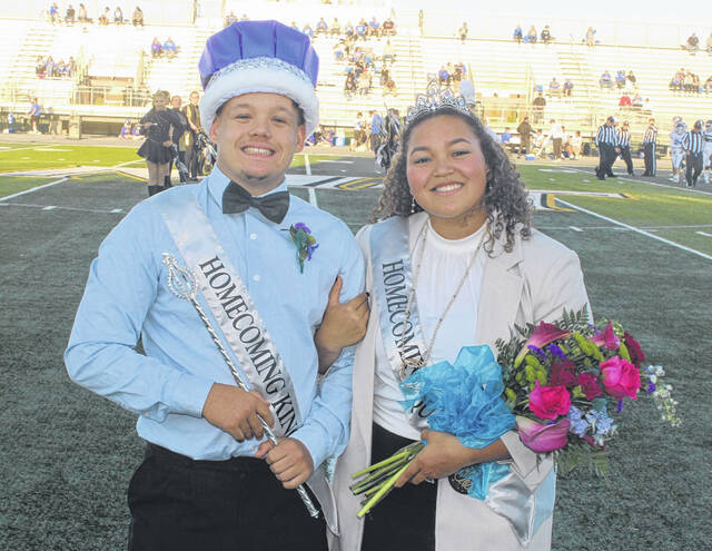 Miami Trace High School Homecoming King Alexander McCarty and Queen Megan Manns stand before a large crowd prior to the game against Chillicothe Friday, Sept. 24, 2021. Please see today's Friday Night Lights page for more Homecoming photos.