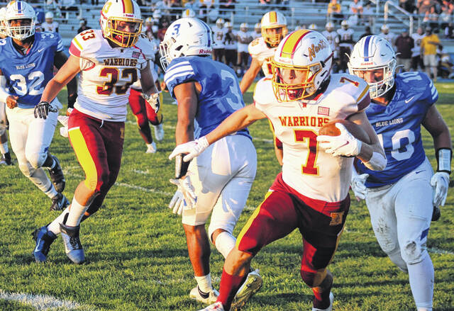 Washington Blue Lion senior Tyler Tackage (10) pursues Westerville North's John Link during the Homecoming game at Gardner Park Friday, Sept. 10, 2021. Also pictured for Washington is junior Trevaughn Jackson (3) and senior Rishaun Burns (32).