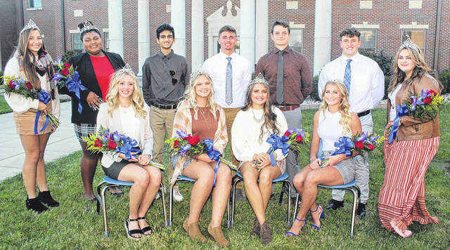The 2021 Homecoming court for Washington High School gathered prior to the parade Wednesday, Sept. 8. (front, l-r); queen candidates, seniors Isabella Racine, Makenna Knisley, Taylor Hixson and Kassidy Olsson; (standing, l-r); junior attendant Megan Sever; freshman attendant Jada Ryan; king candidates, seniors Kishan Patel, Karson Runk, Mac Miller and Tyler Tackage and sophomore attendant Annie Rayburn. The queen and king will be announced just minutes before the Blue Lions take on Westerville North at Gardner Park Friday night.