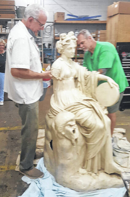 David Terry (right) and his assistant restoring a statue of Thalia on Aug. 3, 2020. This statue of Thalia along with Winged Victory and King Arthur statues have been restored and and are now displayed on the Washington High School and Washington Middle School campus.