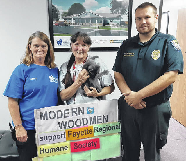 Modern Woodmen will be matching donations to the Fayette Regional Humane Society's Walk Against Animal Cruelty. Pictured (left-to-right) are: Tammy Jo Vance — FRHS Animal Care supervisor, Modern Woodmen member and FRHS member Debra Grover, and FRHS Deputy Humane Agent Johnny Daugherty.