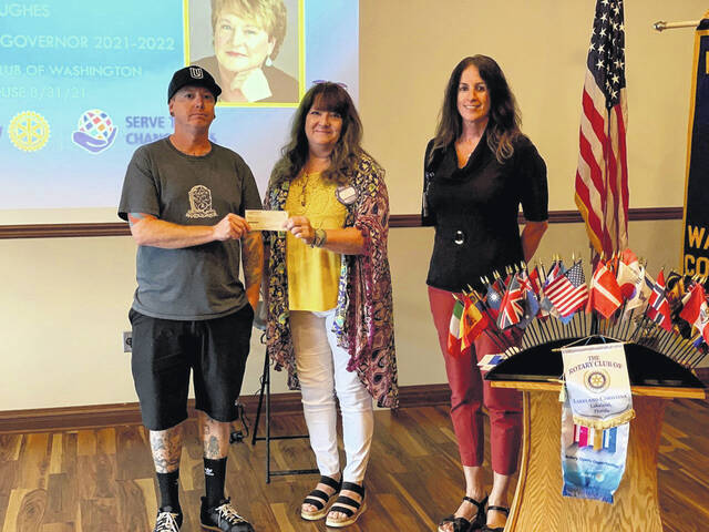 The Washington Rotary Club recently held a raffle and donated the funds to local Jason Stritenberger to go toward the creation of a local disc golf course.