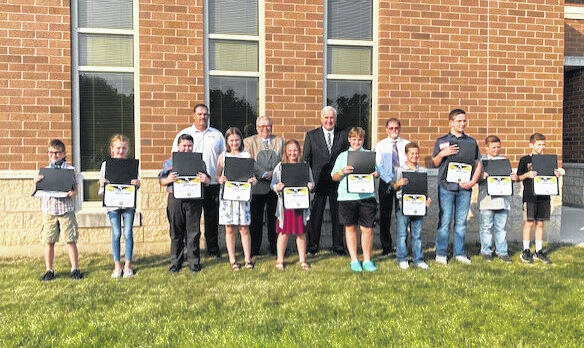 During Monday's Miami Trace School Board meeting, elementary students were recognized for receiving perfect scores on their Spring 2021 Ohio State Test. Pictured (left-to-right) are: Jameson Strider, Addilyn Stanforth, Ralph Moser, Cailin Johnson, Aubrey Ferguson, Hunter Chace, Caleb Esker,Matthew Barnard, Elijah Barnard and Max Johnson. Board members in the back: Rob Dawson, Bruce Kirkpatrick, Mike Henry and Dave Miller.