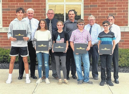 During Monday's Miami Trace School Board meeting, high school and middle school students were recognized for receiving perfect scores on their Spring 2021 Ohio State Test. Students pictured (left-to-right, front) are: Trey Robinette, Alison Reeves, Taylor Payton, River Havens and Dylan Ely. Students not pictured: Allison Cart, Rylee Ferguson, Emily Keaton, Elizabeth Turner, Emily Turner and Kylie Yeazel. Miami Trace board members pictured in the back are Mike Henry, Charlie Andrews, Rob Dawson, Bruce Kirkpatrick, and David Miller.