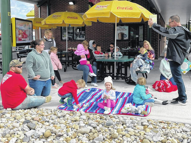 Recently, the library was invited to present Storytime at Sonic Drive-In! In addition to stories and songs, children were treated with warm french fries and delicious ice cream.