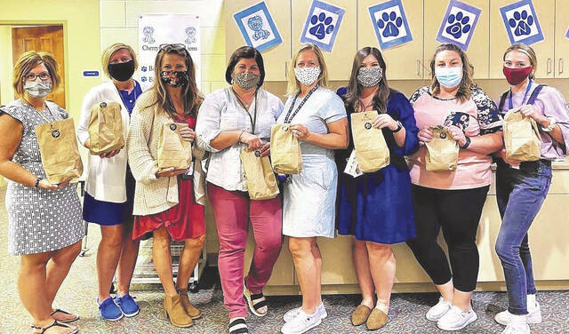 In recognition of World Teachers' Day, Crossroads Christian Church delivered over 500 goody bags to teachers in Fayette County. Pictured are staff members of Washington Court House City Schools.