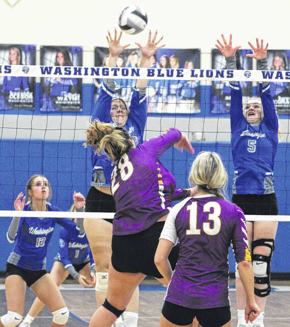 Washington's Haven McGraw (left, at net) and Natalie Woods (5) go for the block at the net during a Frontier Athletic Conference match against McClain Wednesday, Oct. 13, 2021. Also pictured for Washington is Olivia Wayne (at left).
