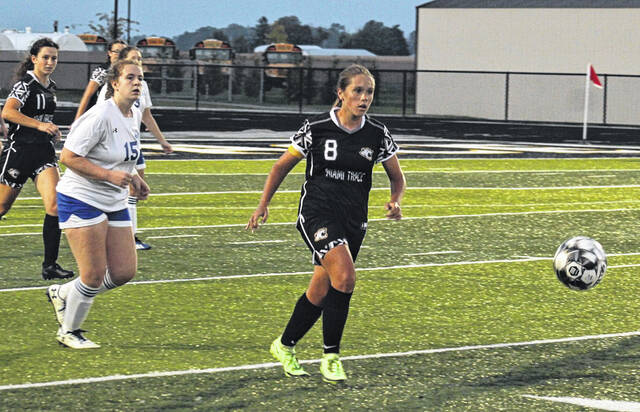 Miami Trace's Carmen Enochs (8) advances the ball up the field during a Frontier Athletic Conference match against Washington Monday, Oct. 4, 2021 at Miami Trace High School. Pictured for Washington is Maycee Skye Whitt (15) and for Miami Trace, Delaney Thomas (11).