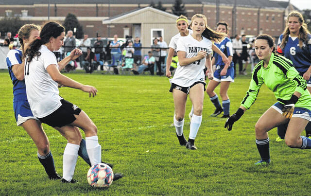 Washington goal-keeper Jordan McCane (right) watches the ball in a close encounter during a Frontier Athletic Conference match with Miami Trace Thursday, Oct. 7, 2021 at Washington High School. At left, for Miami Trace, is Delaney Thomas (11). Also pictured for Miami Trace are Carly Smith (14) and behind her is Jana Griffith. Also pictured for Washington is Kassie Wiseman (6).