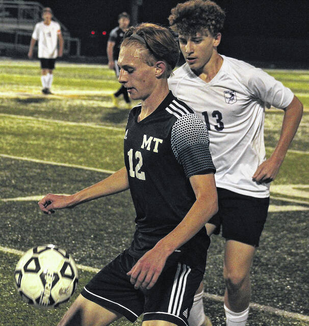 Miami Trace's Logan Johnson (12) settles the ball during a match against the McClain Tigers at Miami Trace High School Tuesday, Oct. 5, 2021.