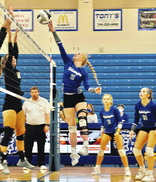 Washington's Natalie Woods (5) hits the return over the net during a match against Miami Trace Saturday, Oct. 9, 2021. Pictured for Miami Trace is Laura Robinson, and for Washington, Allison Mongold (3) and Megan Sever (18).