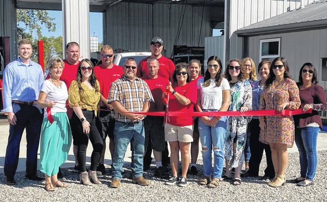 A ribbon cutting was held by the Chamber of Commerce for OK Tire's Grand Opening of their new building. OK Tire was purchased by Andy and Stacey Fitzpatrick on Jan. 18. The Chamber of Commerce was happy to celebrate the grand opening of their new building, located at 1314 US RT 22 N.W., next door to their former address. They can be reached at 740-335-3300.