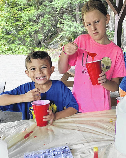 Cortland and Lilah Camp stir up some slime during the camp-out.