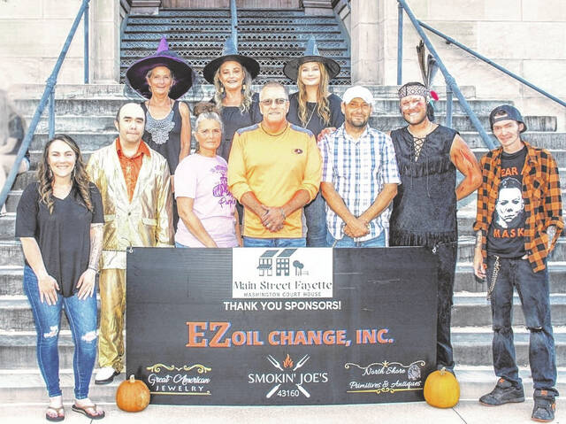During the Shop Hop, a karaoke contest was held. Pictured is an assortment of individuals who helped make the contest a success — including judges, participants and Main Street Fayette members.