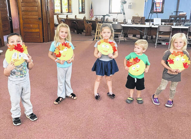 """Storytime kids show off their """"Leaf Man"""" crafts! Bonnie's Books takes place Tuesdays at 11 a.m. at the Jeffersonville United Methodist Church."""