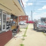 Truck crashes through building