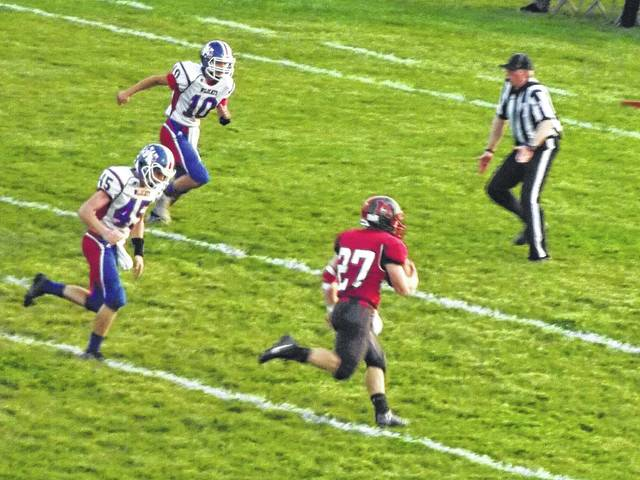 Minford's Casey Gaines runs down the sideline for a Falcons' touchdown.