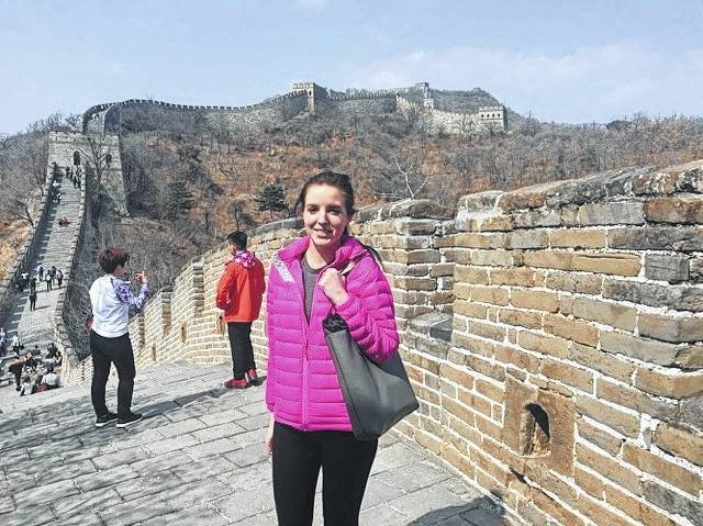 Mikelle Moon standing by the Great Wall of China