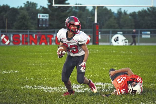Minford's Darius Jordan breaks a tackle and moves upfield on Friday evening.
