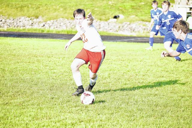 Minford's Eli Cordle attempts to control the ball in a Thursday evening matchup against Northwest.