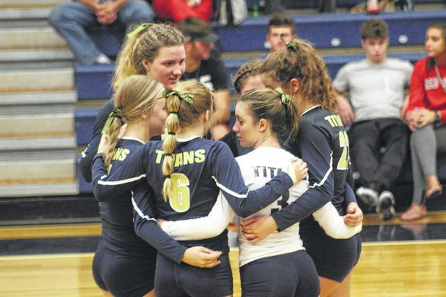 Notre Dame groups up in a huddle before the start of a set on Monday evening.