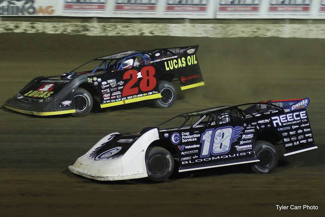 Scott Bloomquist (18) and Earl Pearson, Jr. (28) battle for a position inside the top-five. Both drivers showed off flashback paint schemes as Bloomquist ran in his 1990s style No. 18 while Pearson, Jr. ran a NASCAR throwback in honoring the legacy of the late and great Davey Allison.